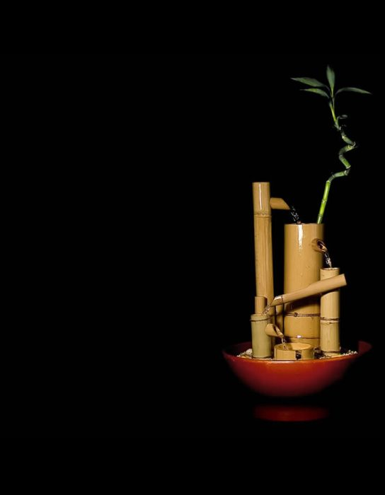 Image with small bamboo water fountain handmade from natural bamboo