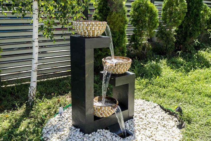 Fantana cascada pentru gradina cu boluri de cupru si piatra naturala pentru activarea energiilor Feng Shui